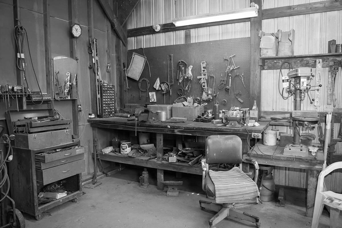 wide shot old barn s workbench with different types tools